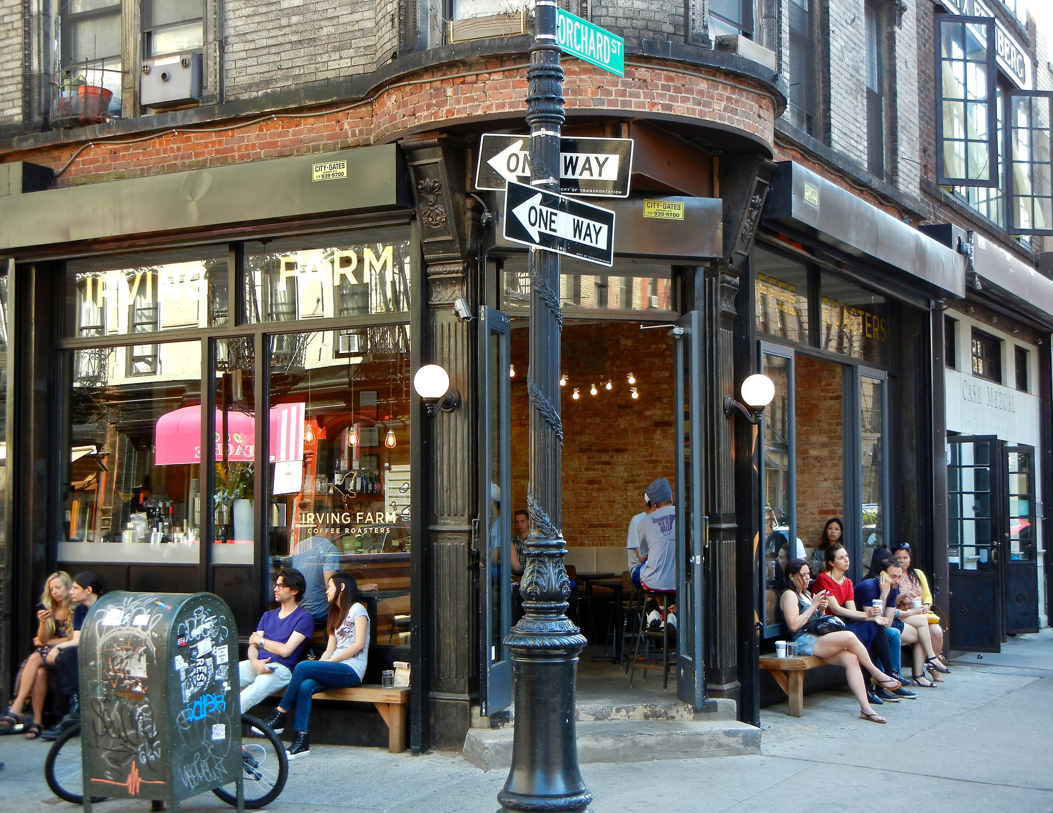 Image of the front of Irving House coffee shop on Orchard Street with people sitting outside